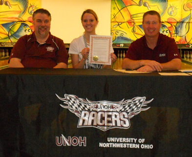 Miranda Blaylock holds her NAIA Letter of Intent with UNOH bowling coach Phil Austin (left) and head coach Todd Book (right)