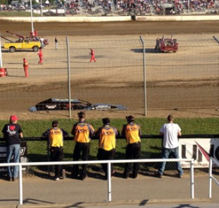 Members of the UNOH Motorsports Team gather at the fence during hot laps Friday night at Limaland Motorsports Park
