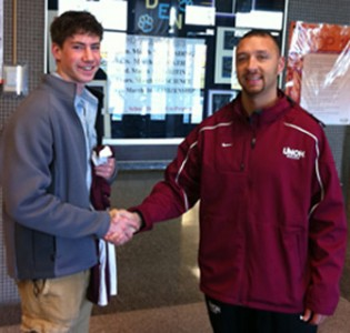 Garrett Renner, seen here with UNOH coach Gavin Oldham, was named a 2012 Scholar-Athelte by The Lima News