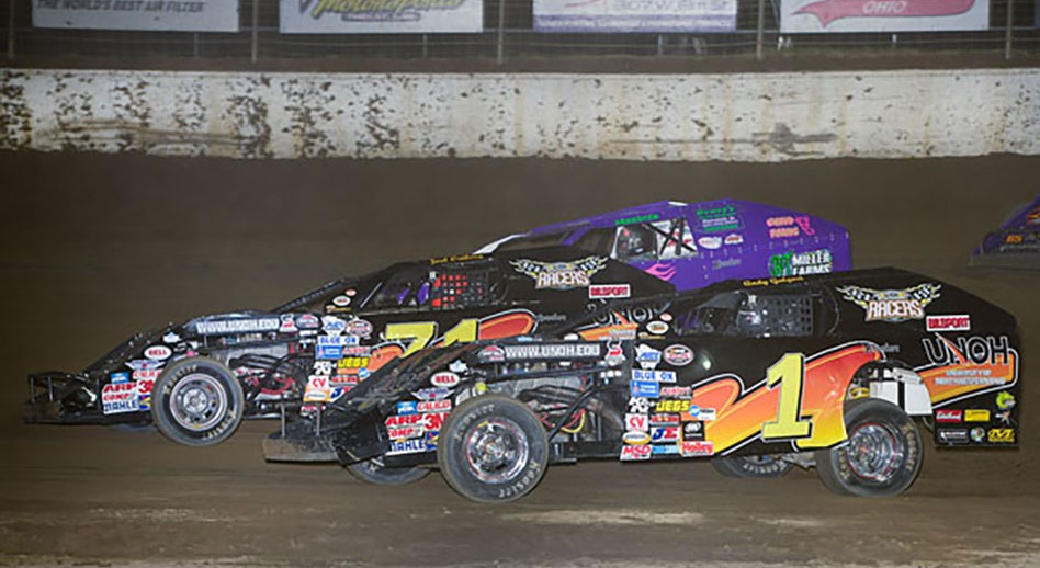 Andy Galgoci (1) Battles Teammate Joel Ortberg (71) For Position in Friday Night's Modified Feature at Limaland (Credit: Mike