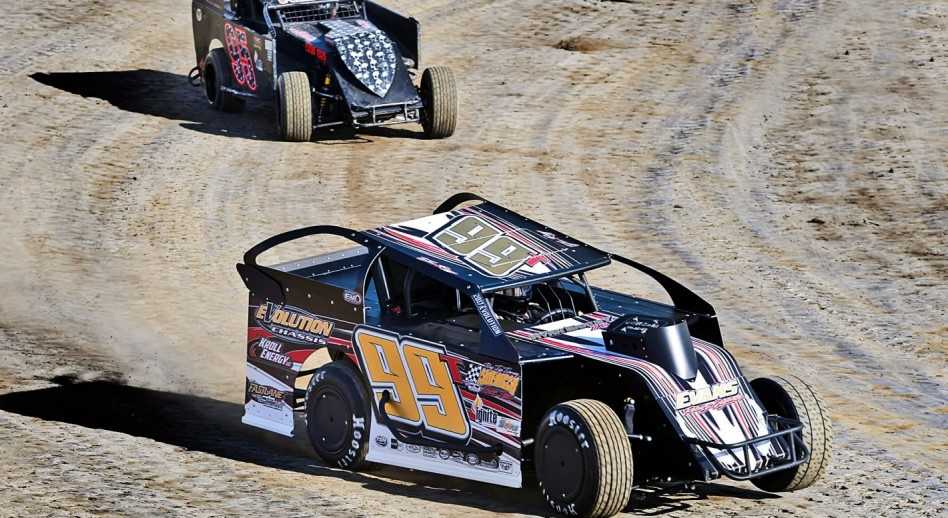 Tyler Riggs (95) leads Jeff Swinford through the turn during Modified Lite hot laps at Limaland. (By Mike Campbell)