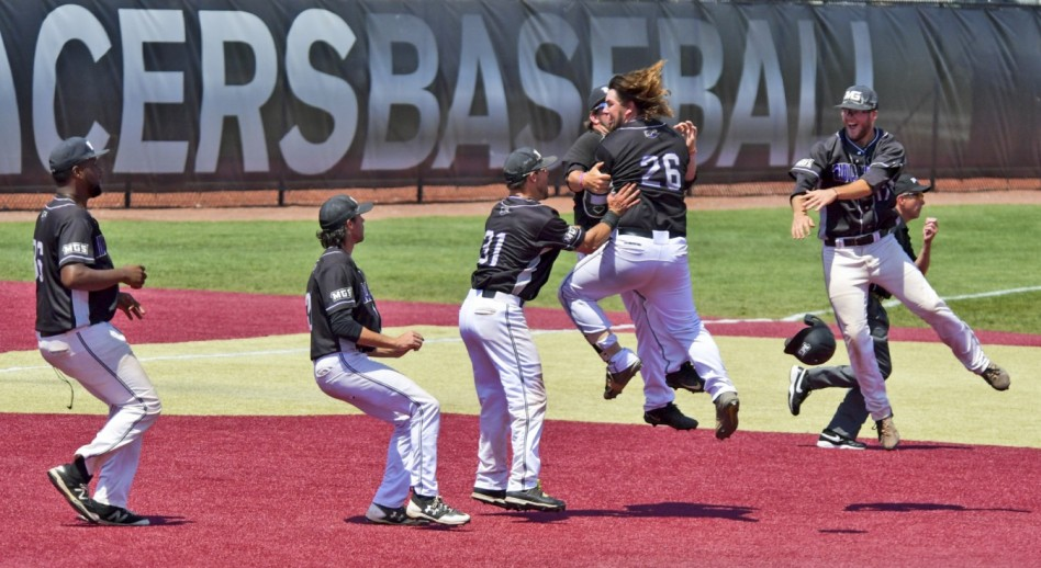 MGA celebrates its walk-off victory in the day's opening marathon. (Photo by Mike Campbell)