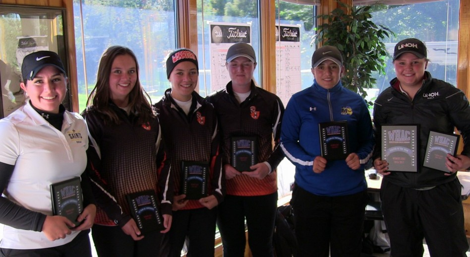 Brianna Baird (right) poses with the All-Conference First Team honorees after being named Player of the Year.