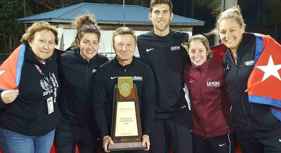 Stuart Gore poses with his assistant coaches and support staff following the NAIA National Championship victory.
